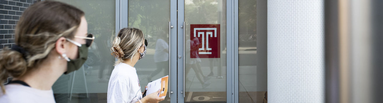 A pair of Temple students entering an on-campus COVID-19 testing site.