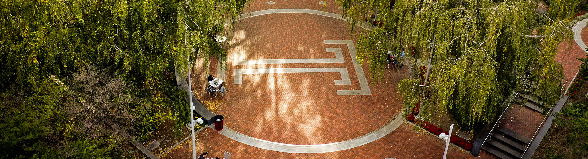 An overhead image of the Temple T in O'Connor Plaza on Main Campus on a sunny fall day