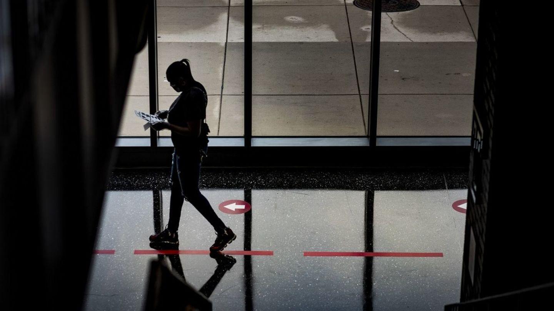A person in silhouette walking through Morgan Hall.